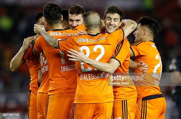 Lucas Alario of River Plate celebrates with teammates after scoring the second goal of his team during a match between River Plate and Banfield as...