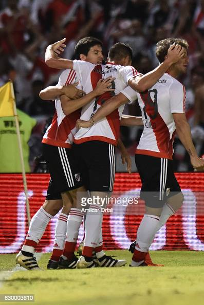 Lucas Alario of River Plate celebrates with teammates after scoring the third goal of his team during a final match between River Plate and Rosario...