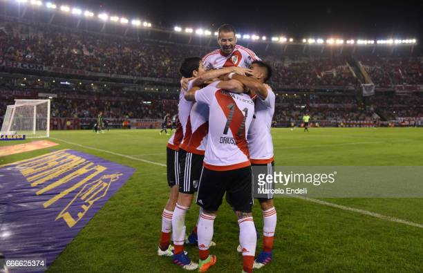Lucas Alario of River Plate celebrates with teammates after scoring the second goal of his team during a match between River Plate and Quilmes as...