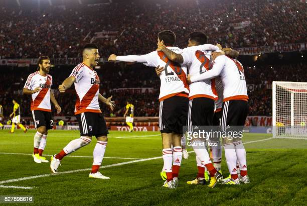 Lucas Alario of River Plate celebrates with teammates after scoring the first goal of his team during a second leg match between River Plate and...