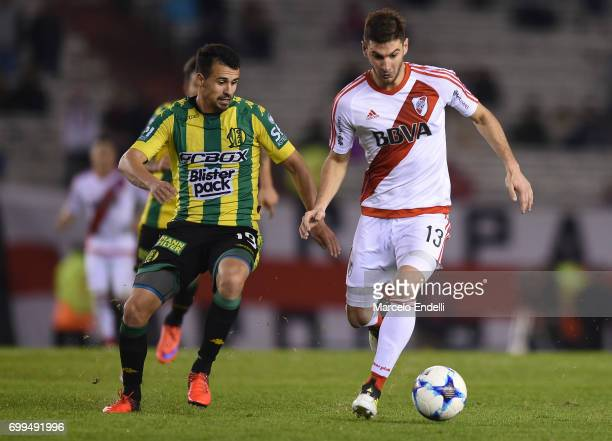 Lucas Alario of River Plate fights for ball with Luis Sosa Otermin of Aldosivi during a match between River Plate and Aldosivi as part of Torneo...