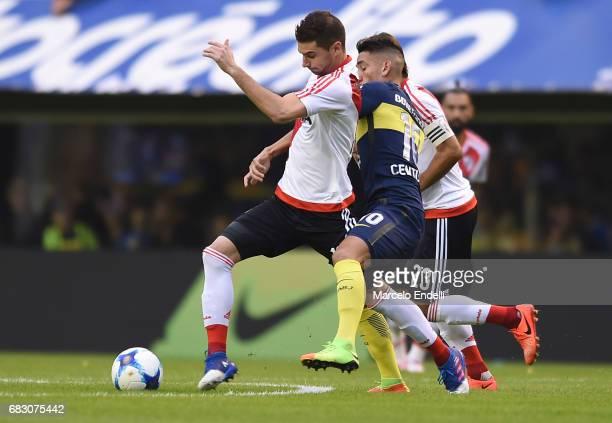 Lucas Alario of River Plate fights for ball with Ricardo Centurion of Boca Juniors during a match between Boca Juniors and River Plate as part of...