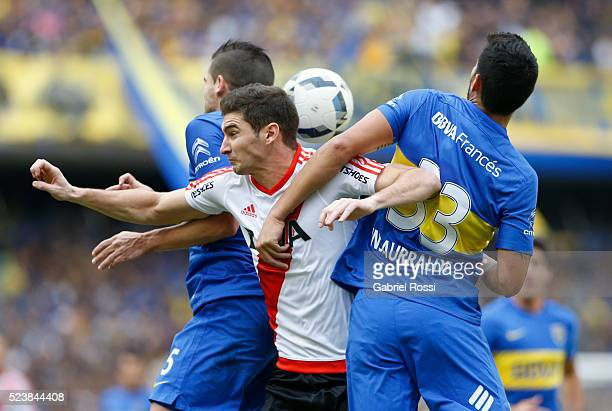 Lucas Alario of River Plate fights for the ball with Juan Manuel Insaurralde of Boca Juniors during a match between Boca Juniors and River Plate as...