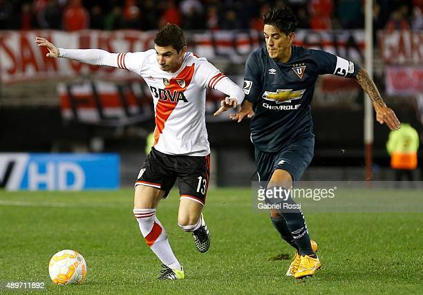 Lucas Alario of River Plate fights for the ball with Norberto Araujo of Liga de Quito during a first leg match between River Plate and Liga Deportiva...