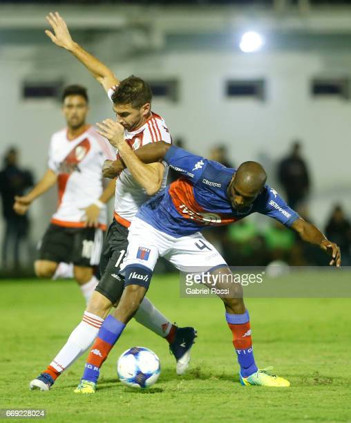 Lucas Alario of River Plate fights for the ball with Paulo Lima Simoes of Tigre during a match between Tigre and River Plate as part of Torneo...