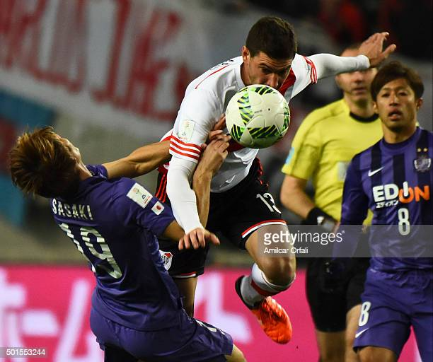 Lucas Alario of River Plate fouls Sho Sasaki of Sanfrecce Hiroshima during the FIFA Club World Cup semi final match between Sanfrecce Hiroshima and...