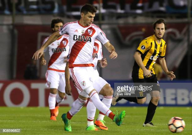 Lucas Alario of River Plate kicks the ball during a first leg match between Guarani and River Plate as part of round of 16 of Copa CONMEBOL...