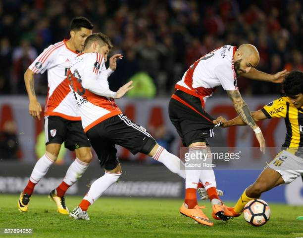 Lucas Alario of River Plate kicks the ball to score the first goal of his team during a second leg match between River Plate and Guarani as part of...