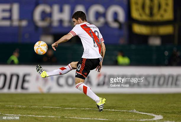 Lucas Alario of River Plate kicks the ball to scores the first goal to his team during a second leg Semi Final match between Guarani and River Plate...