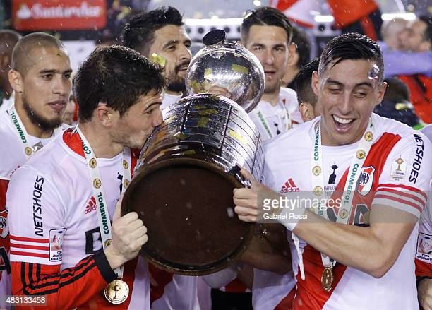 Lucas Alario of River Plate kisses the Copa Libertadores trophy after the final match between River Plate and Tigres UANL as part of Copa Bridgestone...