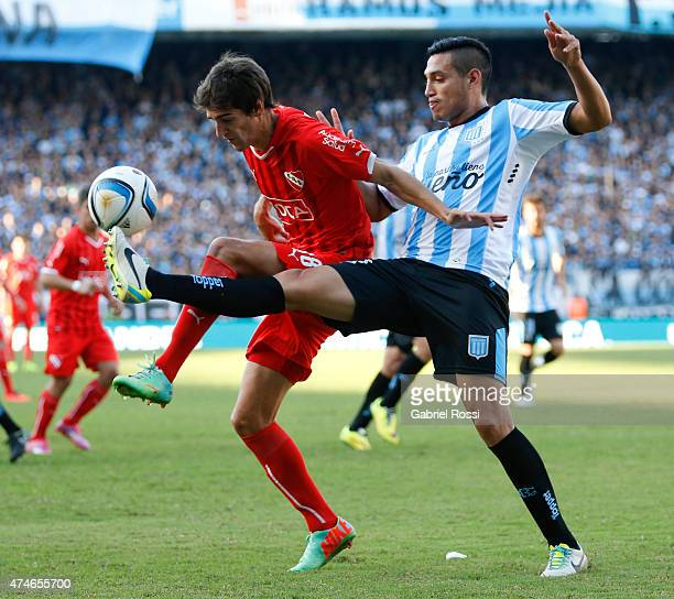 Lucas Albertengo of Independiente fights for the ball with Yonathan Cabral of Racing Club during a match between Racing Club and Independiente as...
