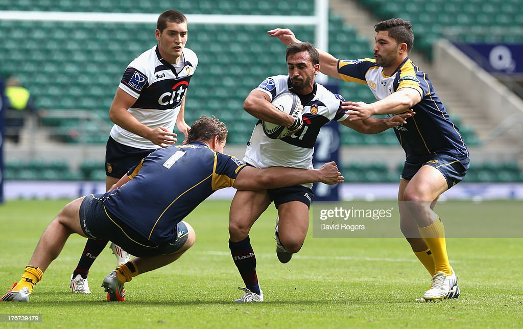 Lucas Alcacer of Buenos Aires is tackled by Etienne Oosthuizen (L) and Colby Faingaa of the ACT Brumbies during the Cup semi final during the World Club 7's at Twickenham Stadium on August 18, 2013 in London, England.