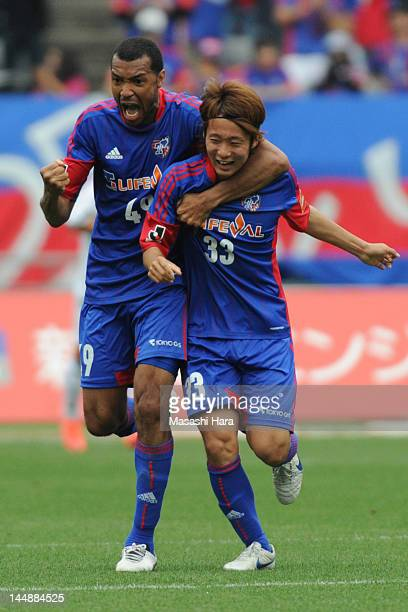 Lucas and Kenta Mukuhara of FC Tokyo celebrate the second goal during the JLeague match between Omiya FC Tokyo and Sagan Tosu at Ajinomoto Stadium on...