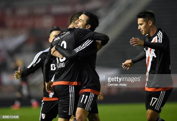 Lucas Arario of River Plate celebrates with teammates after scoring the first goal of his team during a match between River Plate and Instituto as...