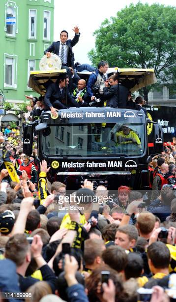 Lucas Barrios and Dede lift the trophy and celebrates winning the German championship with team mates and fans during the Borussia Dortmund...