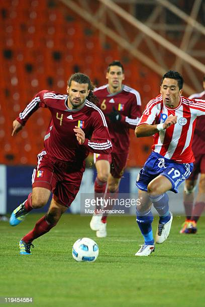 Lucas Barrios from Paraguay fights for the ball against Oswaldo Vizcarrondo from Venezuela during a semi final match between Paraguay and Venezuela...