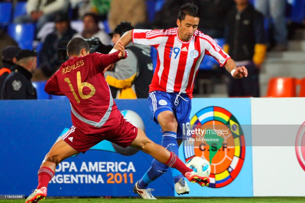 <a gi-track='captionPersonalityLinkClicked' href=/galleries/search?phrase=Lucas+Barrios&family=editorial&specificpeople=4142497 ng-click='$event.stopPropagation()'>Lucas Barrios</a> from Paraguay (LCR) fights for the ball against Roberto Rosales from Venezuela during a semi final match between Paraguay and Venezuela at Malvinas Argentinas Stadium on July 20, 2011 in Mendoza, Argentina.