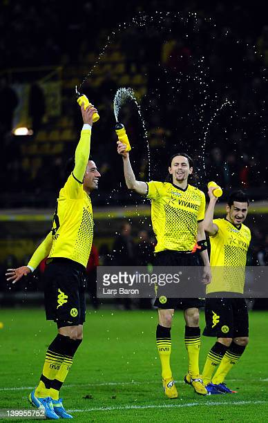 Lucas Barrios Neven Subotic and Ilkay Guendogan celebrate after winning the Bundesliga match between Borussia Dortmund and Hannover 96 at Signal...