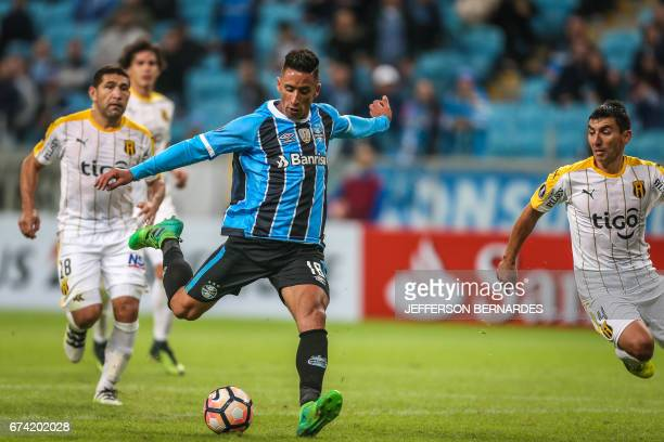 Lucas Barrios of Brazil's Gremio kicks to score against Paraguay's Guarani during their Copa Libertadores 2017 football match held at the Arena do...