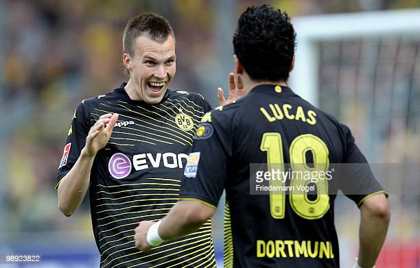 Lucas Barrios of Dortmund celebrates after scoring his team's first goal with team mate Kevin Grosskreutz during the Bundesliga match between SC...