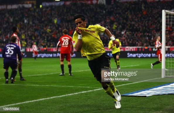 Lucas Barrios of Dortmund celebrates after scoring the opening goal during the Bundesliga match between FC Bayern Muenchen and Borussia Dortmund at...