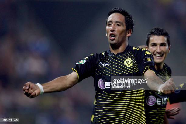Lucas Barrios of Dortmund celebrates his team's third goal during the DFB Cup second round match between Karlsruher SC and Borussia Dortmund at the...