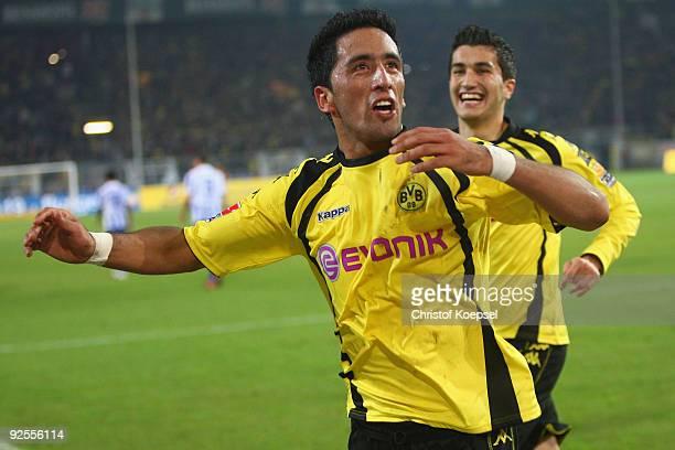 Lucas Barrios of Dortmund celebrates the second goal with Nuri Sahin during the Bundesliga match between Borussia Dortmund and Hertha BSC Berlin at...