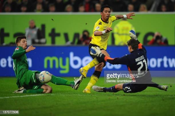 Lucas Barrios of Dortmund is challenged by goalkeeper Sebastian Mielitz of Bremen during the Stadtwerke Duesseldorf Wintercup 2012 third place match...