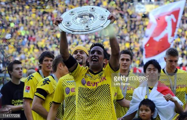 Lucas Barrios of Dortmund lifts the trophy after the Bundesliga match between Borussia Dortmund and Eintracht Frankfurt at Signal Iduna Park on May...