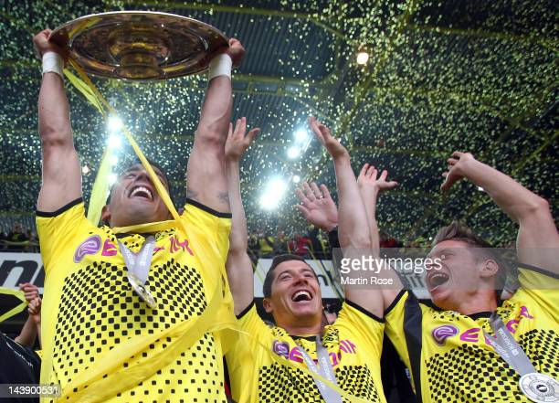 Lucas Barrios of Dortmund lifts the trophy after winning the german championship after the Bundesliga match between Borussia Dortmund and SC Freiburg...
