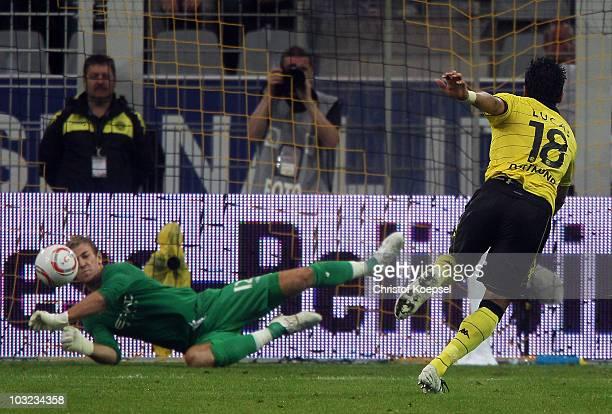 Lucas Barrios of Dortmund shoots a penalty and Joe Hart of Manchester City saves the ball during the preseason friendly match between Borussia...
