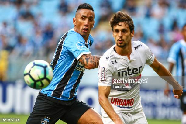 Lucas Barrios of Gremio battles for the ball against Rodrigo Caio of Sao Paulo during the match between Gremio and Sao Paulo as part of the...