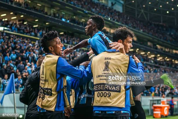 Lucas Barrios of Gremio celebrates with teammates after scoring against Paraguay's Guarani during their Copa Libertadores 2017 football match held at...
