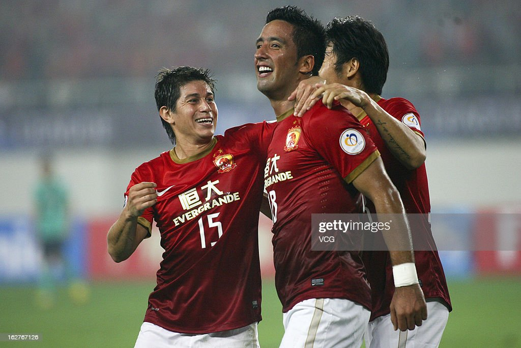 Lucas Barrios of Guangzhou Evergrande celebrates with teammate Dario Conca after scoring his team's first goal during the AFC Champions League match...