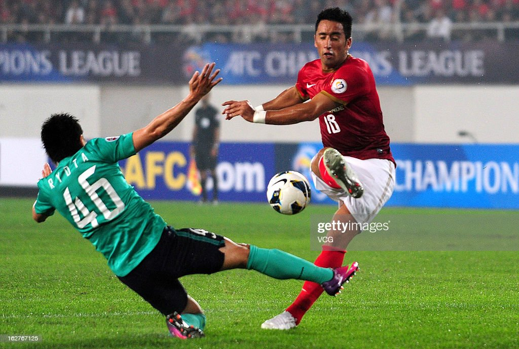 <a gi-track='captionPersonalityLinkClicked' href=/galleries/search?phrase=Lucas+Barrios&family=editorial&specificpeople=4142497 ng-click='$event.stopPropagation()'>Lucas Barrios</a> (R) of Guangzhou Evergrande shoots the ball against Ryota Moriwaki (L) of Urawa Red Diamonds during the AFC Champions League match between Guangzhou Evergrande and Urawa Red Diamonds at Tianhe Sports Center on February 26, 2013 in Guangzhou, China.