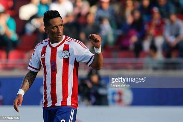 Lucas Barrios of Paraguay celebrates after scoring the first goal of his team during the 2015 Copa America Chile Group B match between Uruguay and...