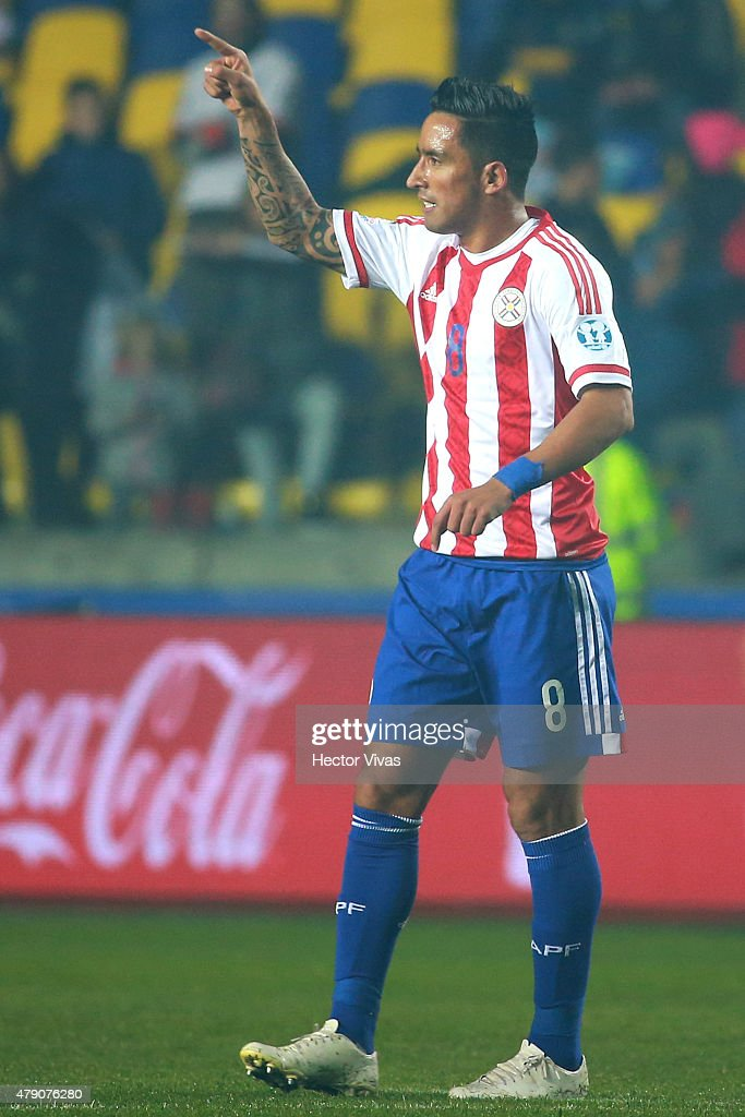 <a gi-track='captionPersonalityLinkClicked' href=/galleries/search?phrase=Lucas+Barrios&family=editorial&specificpeople=4142497 ng-click='$event.stopPropagation()'>Lucas Barrios</a> of Paraguay celebrates after scoring the first goal of his team during the 2015 Copa America Chile Semi Final match between Argentina and Paraguay at Ester Roa Rebolledo Stadium on June 30, 2015 in Concepcion, Chile.