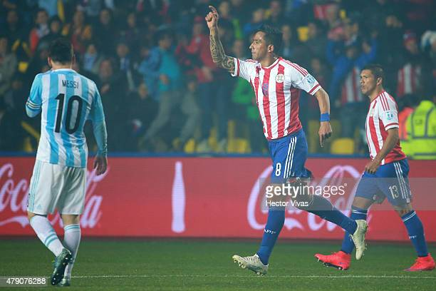 Lucas Barrios of Paraguay celebrates after scoring the first goal of his team during the 2015 Copa America Chile Semi Final match between Argentina...