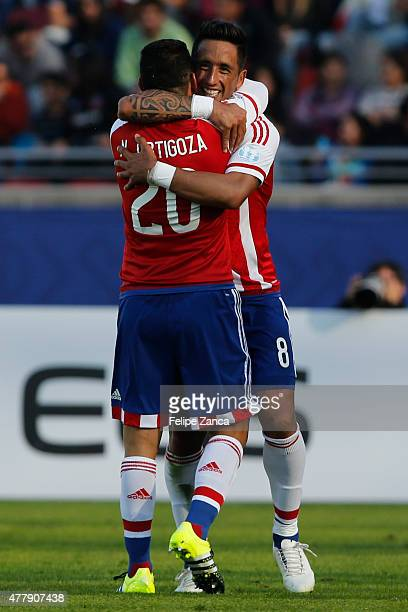 Lucas Barrios of Paraguay celebrates with teammate Nestor Ortigoza after scoring the first goal of his team during the 2015 Copa America Chile Group...