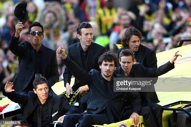 Lucas Barrios Robert Lewandowski Ivan Perisic Mats Hummels Chris Loewe and Neven Subotic of Dortmund wave to the fans during a parade at Borsigplatz...