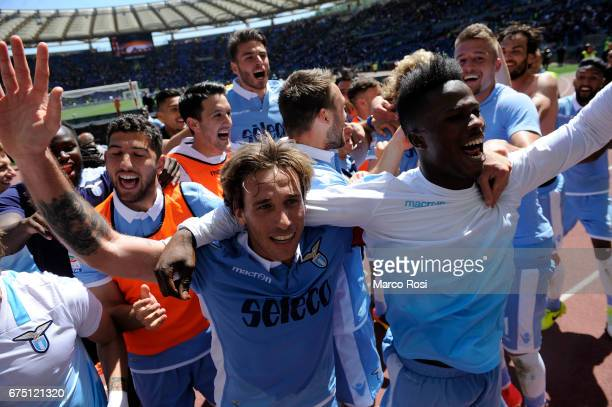 Lucas Biglia and Balde Diao Keita of SS Lazio celebrate victory after the Serie A match between AS Roma and SS Lazio at Stadio Olimpico on April 30...