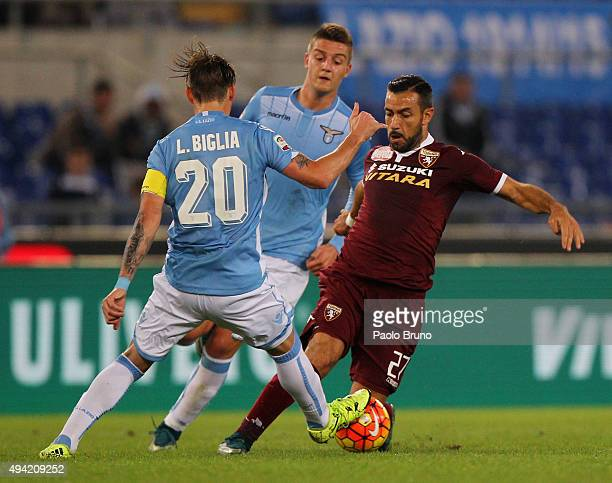 Lucas Biglia and Sergej MilinkovicSavic of SS Lazio competes for the ball with Fabio Quagliarella of Torino FC during the Serie A match between SsS...