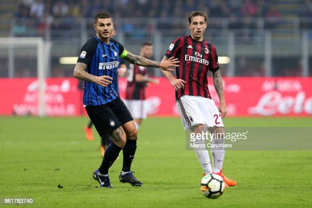 Lucas Biglia of Ac Milan and Mauro Icardi of FC Internazionale in action during the Serie A football match between FC Internazionale and AC Milan Fc...
