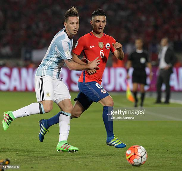 Lucas Biglia of Argentina and Felipe Gutierrez of Chile fight for the ball during a match between Chile and Argentina as part of FIFA 2018 World Cup...