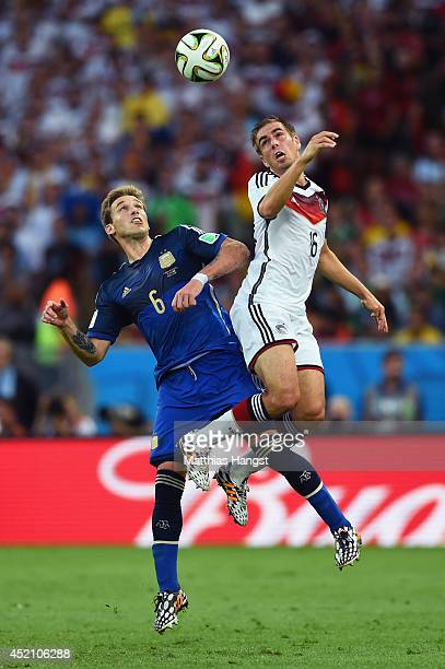 Lucas Biglia of Argentina and Philipp Lahm of Germany go up for a header during the 2014 FIFA World Cup Brazil Final match between Germany and...