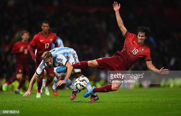 Lucas Biglia of Argentina and Tiago of Portugal battle for the ball during the International Friendly between Argentina and Portugal at Old Trafford...