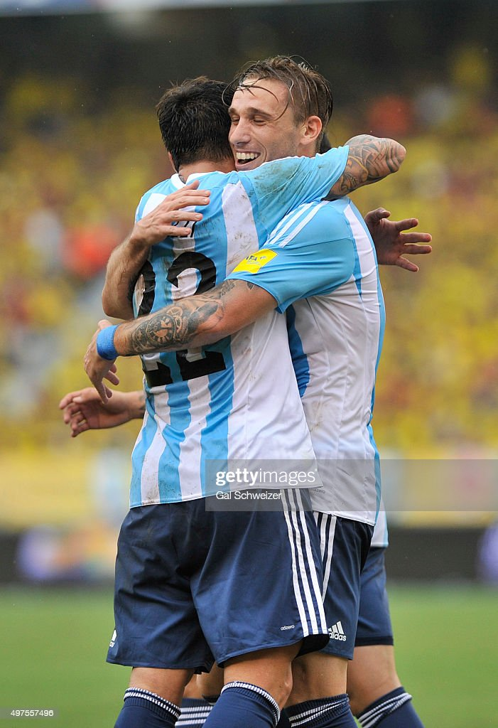 Lucas Biglia of Argentina celebrates with teammate Ezequiel Lavezzi after scoring the opening goal during a match between Colombia and Argentina as part of FIFA 2018 World Cup Qualifiers at Metropolitano Stadium on November 17, 2015 in Barranquilla, Colombia.