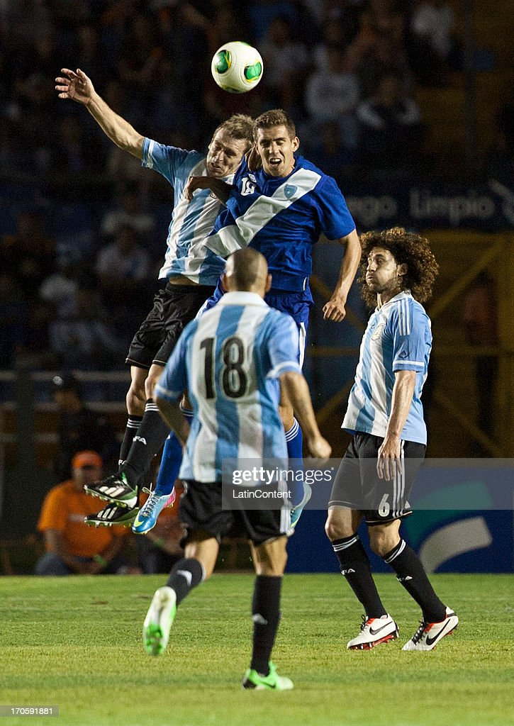 <a gi-track='captionPersonalityLinkClicked' href=/galleries/search?phrase=Lucas+Biglia&family=editorial&specificpeople=627651 ng-click='$event.stopPropagation()'>Lucas Biglia</a> of Argentina competes for the ball with Milton Leal of Guatemala during a friendly soccer match between Argentina and Guatemala at Mateo Flores stadium on June 14 in Guatemala City, Guatemala.
