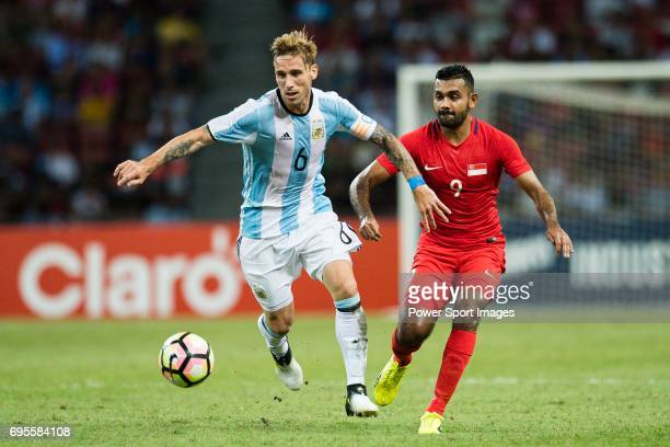 Lucas Biglia of Argentina fights for the ball with Faritz Hameed of Singapore during the International Test match between Argentina and Singapore at...