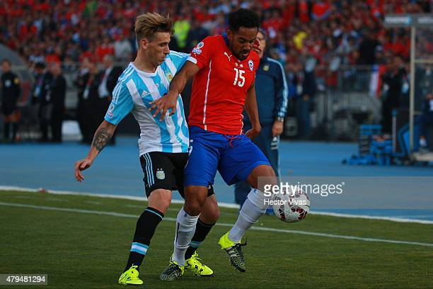 Lucas Biglia of Argentina fights for the ball with Jean Beausejour of Chile during the 2015 Copa America Chile Final match between Chile and...